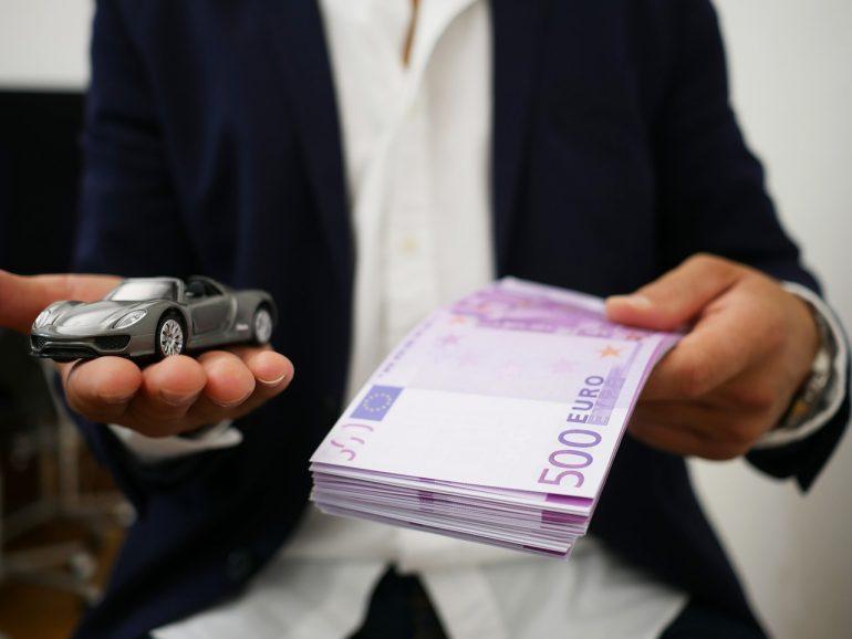 Rent luxury car - person holding money